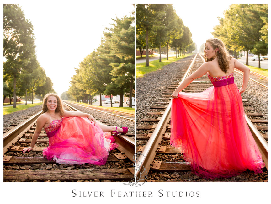 Beautiful coral and pink dress stands out against railroad tracks in Gibsonville, North Carolina