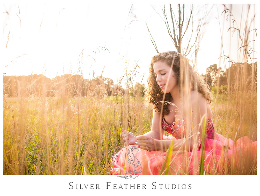 Ariana poses in beautiful golden light by Lake Mackintosh. Photography by North Carolina Wedding Photographer.