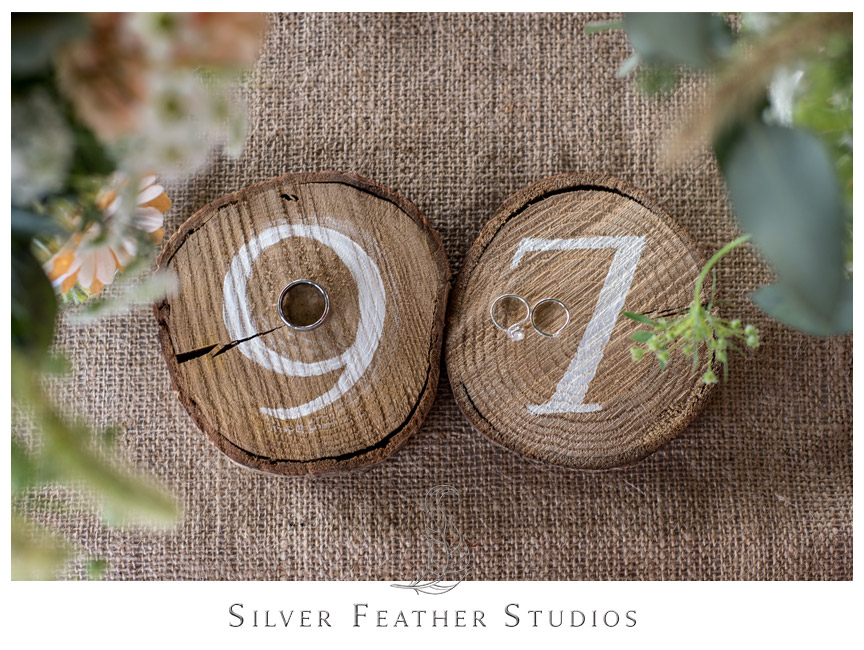 Wooden trunk table numbers with the rings at Starlight Meadows.