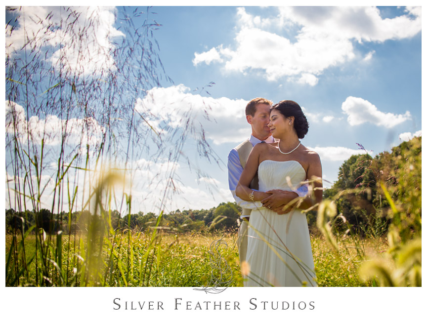 Gorgeous bride and groom pose in the sunlight at Starlight Meadow in Burlington , NC.