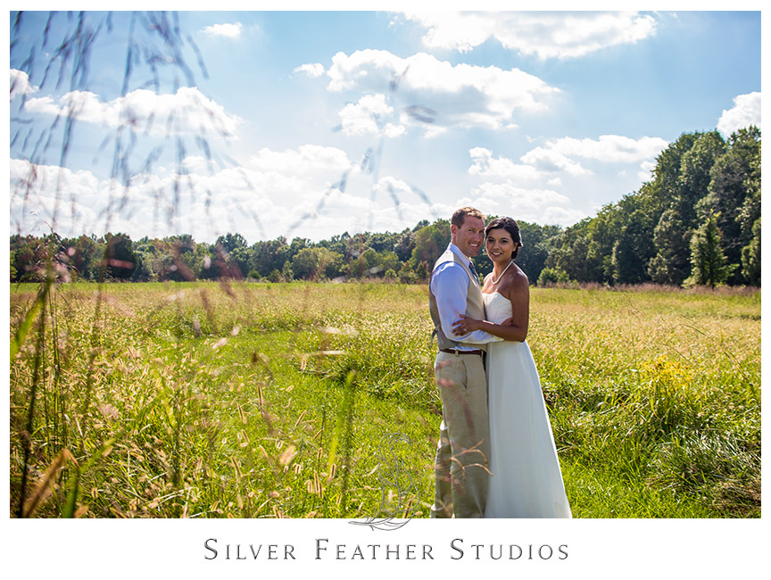 Ben and Samantha pose for their wedding portraits at Starlight Meadow in Burlington NC.  © Silver Feather Studios
