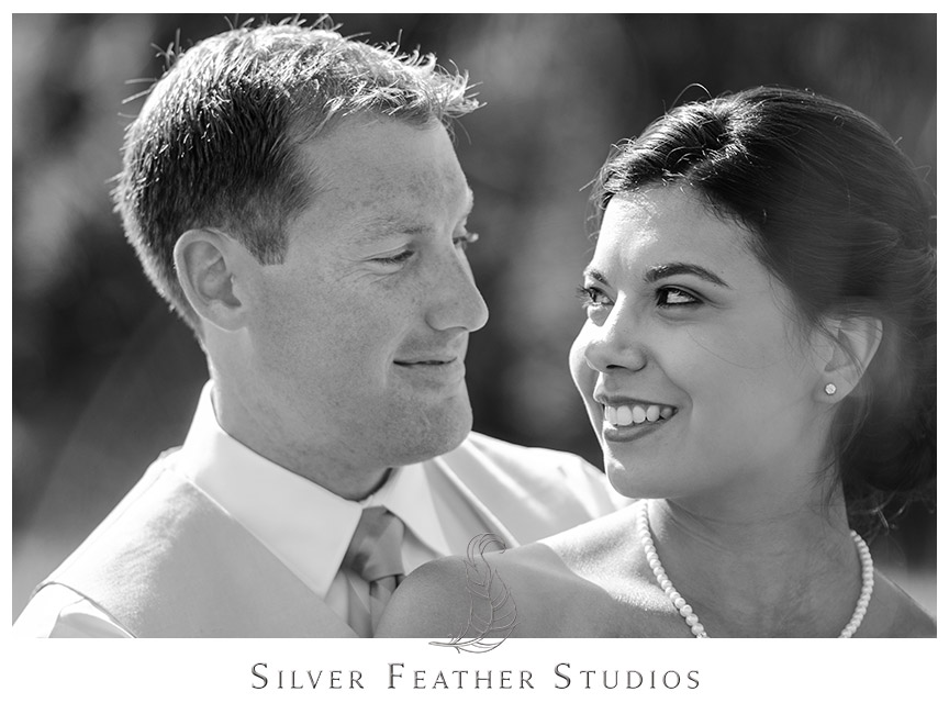 Black and white image of the bride and groom looking into each other's eyes at Starlight Meadow. © Silver Feather Studios