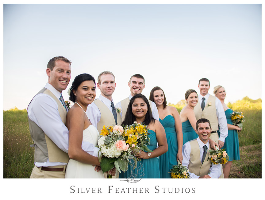 The bridal party pose with their bouquets in the fields of Starlight Meadow. © Silver Feather Studios, Burlington, NC Wedding Photography