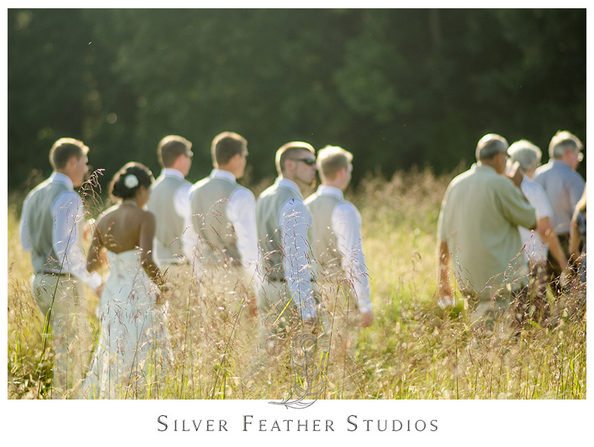 Beautiful golden fields adorn this outdoor barn venue.  © Silver Feather Studios, Burlington, NC Wedding Photography