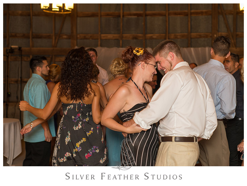 Fun and dancing at this Starlight Meadow wedding. © Silver Feather Studios, Burlington, NC Wedding Photography