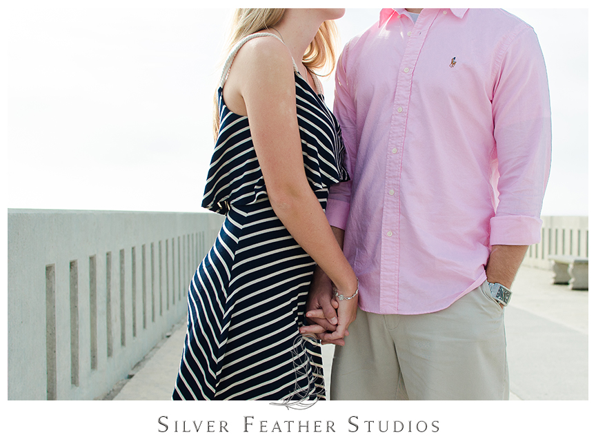 Couples engagement session at Johnnie Mercers Fishing Pier in Wilmington, NC. © Silver Feather Studios, Burlington, NC Wedding Photography & Videography
