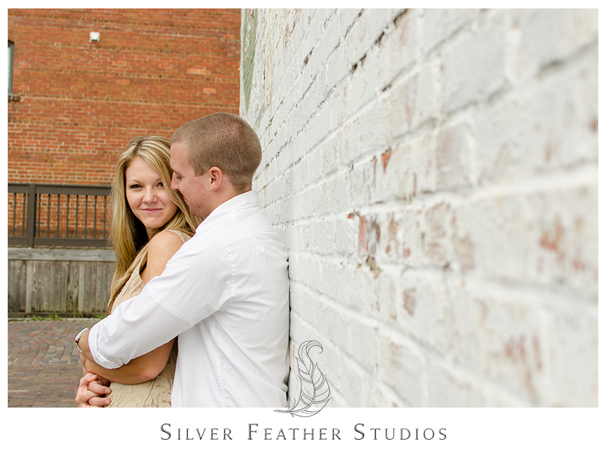 Megan and Jay cuddle at their chic engagement session in historical downtown Wilmington, NC.  © Silver Feather Studios, Burlington, NC Wedding Photography & Videography