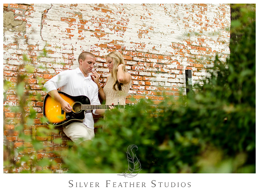 Romantic guitar playing at this chic engagement session in historical downtown Wilmington with Megan and Jay.  © Silver Feather Studios, Burlington, NC Wedding Photography & Videography