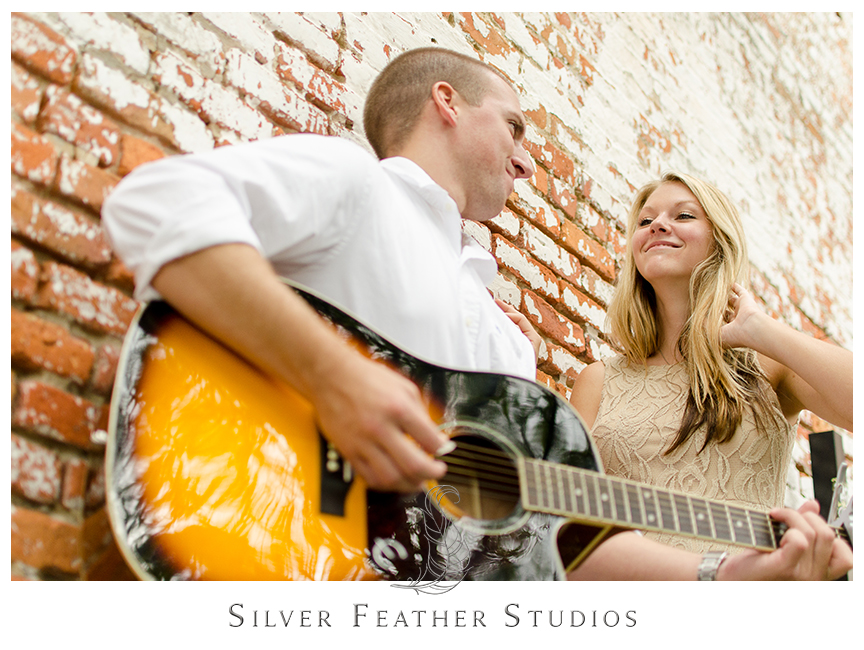 Romantic guitar playing at this chic engagement session in historical downtown Wilmington with Megan and Jay.© Silver Feather Studios, Burlington, NC Wedding Photography & Videography
