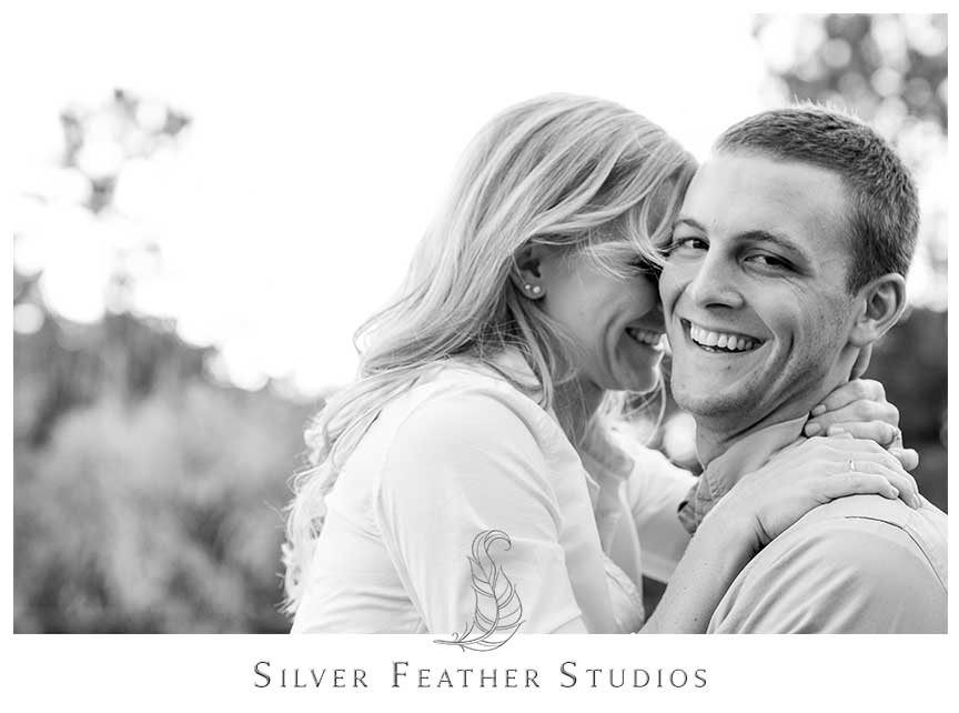 Sweet cuddling at this romantic autumn engagement session at Fearrington Village. © Silver Feather Studios, Chapel Hill Wedding Videography and Photography