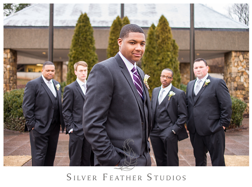 Groomsmen in grey, silver and purple at this Bryan Park Conference Center wedding reception. © Silver Feather Studios, Greensboro, North Carolina Wedding Photography