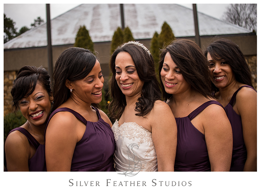 Bride and her bridesmaid in purple at this Bryan Park Conference Center wedding reception. © Silver Feather Studios, Greensboro, North Carolina Wedding Photography