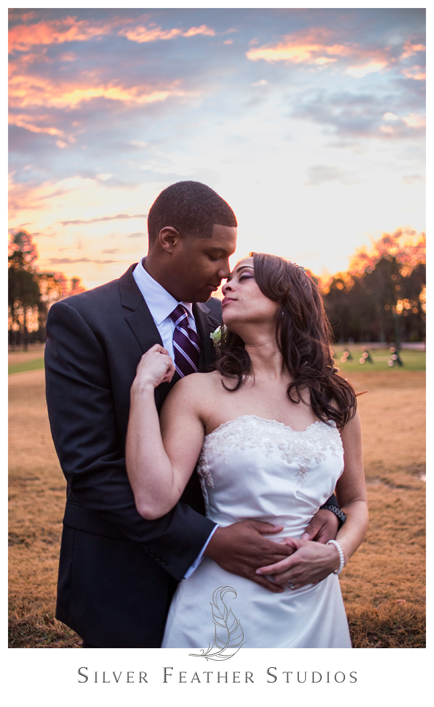 Marcellus and Lisa pose together outside their Bryan Park Conference Center wedding reception. © Silver Feather Studios, Greensboro, North Carolina Wedding Photography