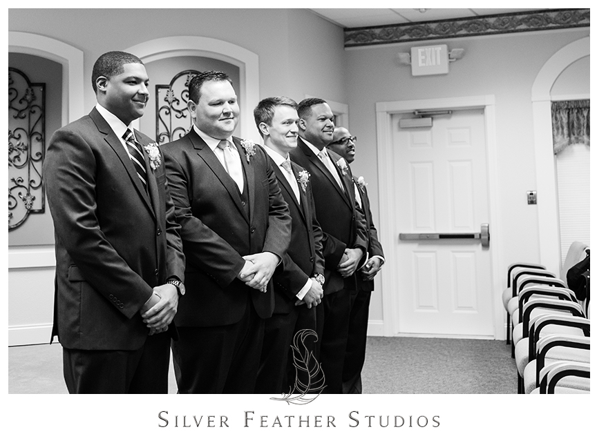 Groom and groomsmen wait for the bride at the Kingdom Hall of Jehovah's Witnesses. © Silver Feather Studios, Wedding Photography in Greensboro, North Carolina.