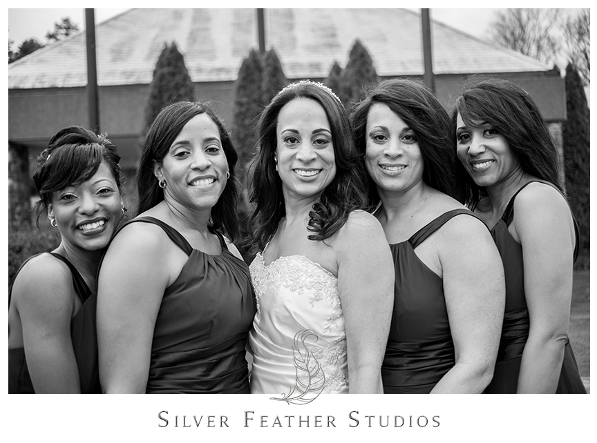 Bridesmaids pose with the bride at this Bryan Park Golf Center wedding. © Silver Feather Studios, Wedding Photography in Greensboro, North Carolina.