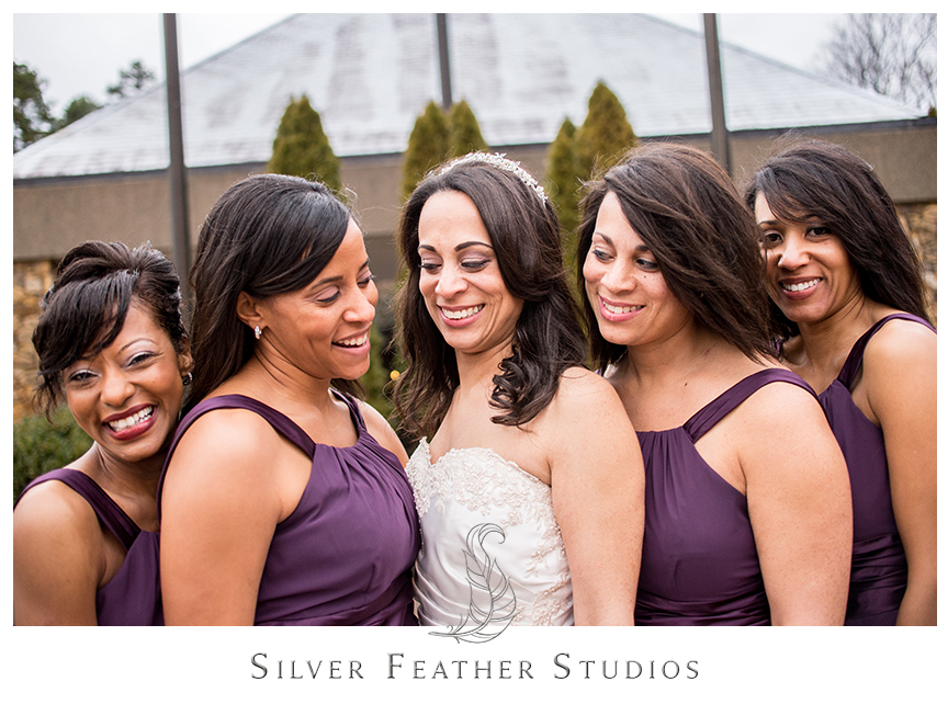 Bridesmaid pose in their purple chiffon dresses at this Bryan Park Golf Center Wedding. © Silver Feather Studios, Wedding Photography in Greensboro, North Carolina.