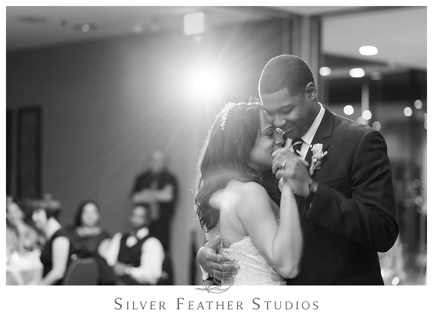 Bride and groom have their first dance at their Bryan Park Golf Center Wedding reception. © Silver Feather Studios, Wedding Photography in Greensboro, North Carolina.