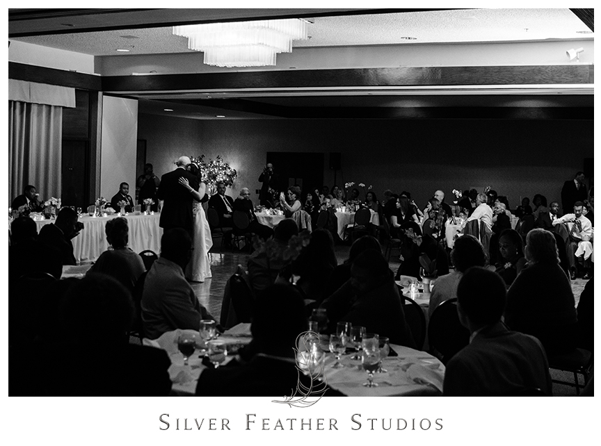 An emotional father and daughter dance at the Bryan Park Golf Center Wedding reception. © Silver Feather Studios, Wedding Photography in Greensboro, North Carolina.