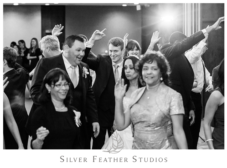 Instructor teaches guests a special dance at this Bryan Park Golf Center Wedding reception. © Silver Feather Studios, Wedding Photography in Greensboro, North Carolina.