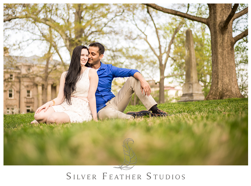 Madison and Harsh pose on the lawn during their UNC Chapel Hill engagement session. © Silver Feather Studios, Chapel Hill Wedding Cinematography & Photography