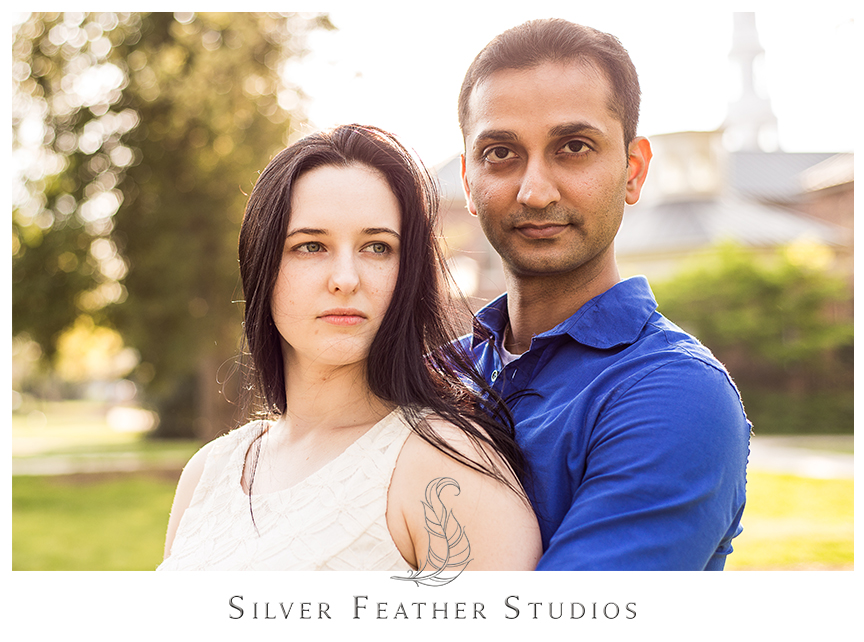 Couple photographed at UNC Chapel Hill for their engagement session wearing ivory and blue. © Silver Feather Studios, Chapel Hill Wedding Cinematography & Photography