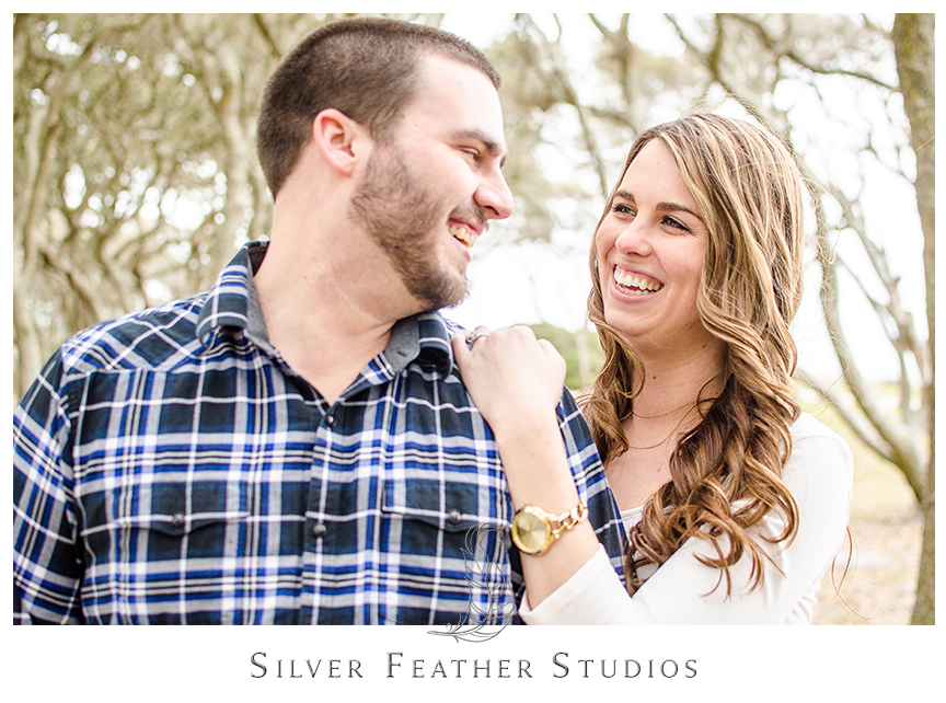 Jessica wears an ivory peplum shirt with jeans at her engagement session at Fort Fisher in Kure Beach, NC. © Silver Feather Studios, Burlington, NC Wedding photography and cinematography.