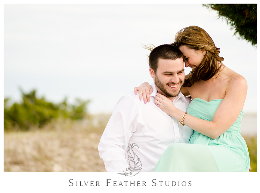 Jessica looks stunning in a strapless mint dress at herFort Fisher engagement session in Kure Beach, NC. © Silver Feather Studios, Burlington, NC Wedding photography and cinematography.