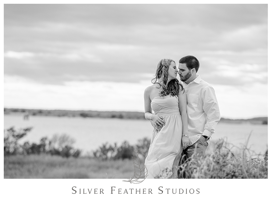 Beautiful black and white image from Jessica and Andrew's Fort Fisher engagement session in Kure Beach, NC. © Silver Feather Studios, Burlington, NC Wedding photography and cinematography.