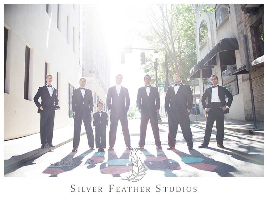 Groomsmen black lit at this classy black and feather inspired wedding at the Empire room in Greensboro. © Silver Feather Studios, Empire Room Wedding Photography & Videography