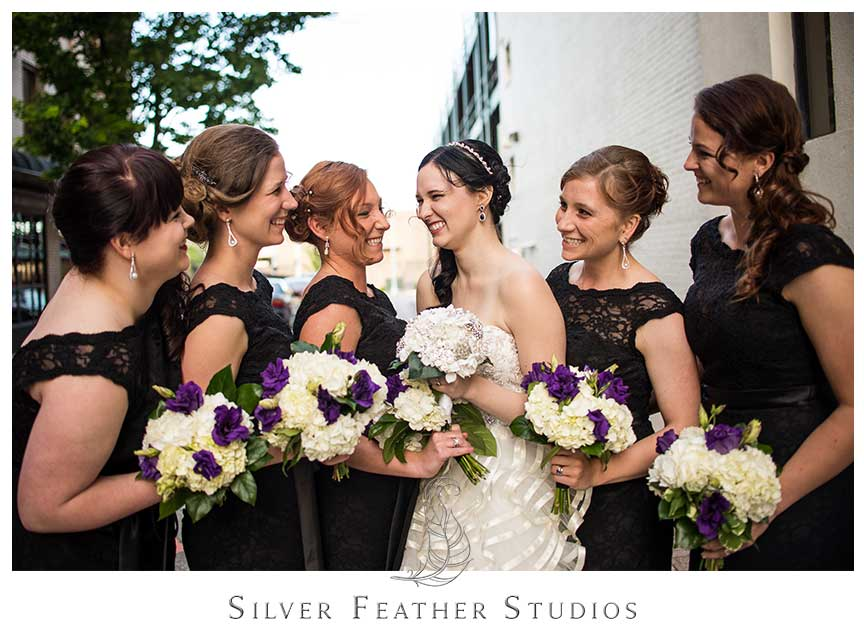 Bride poses with her bridesmaids at her gorgeous black lace and feather inspired wedding at the Empire room in Greensboro. © Silver Feather Studios, Empire Room Wedding Photography and Videography