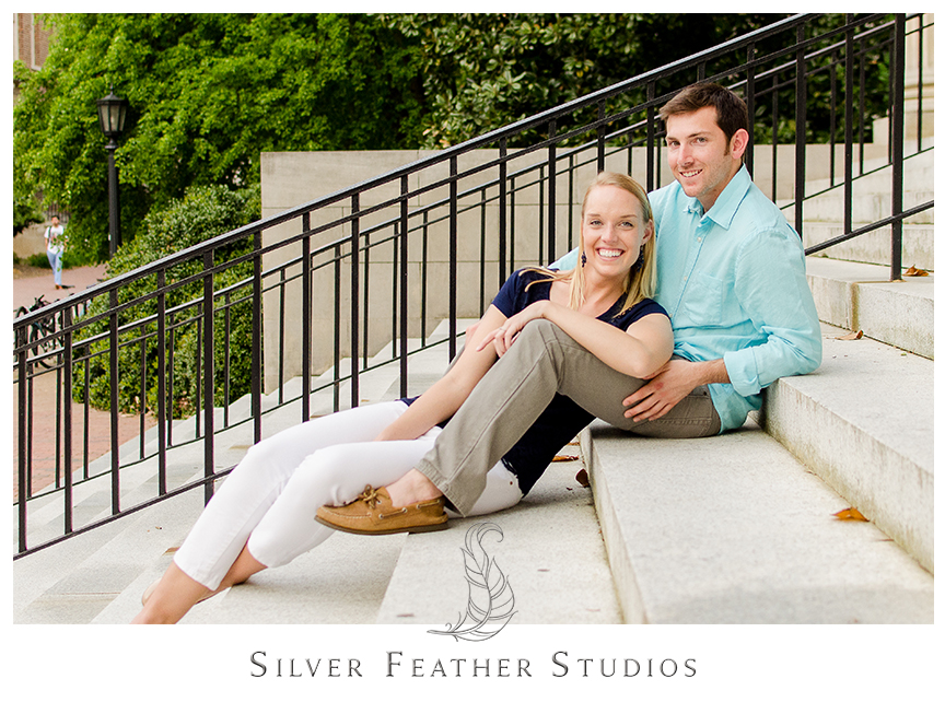 Erin and Jacob pose outside the library with UNC Chapel Hill wedding photographer and video, Silver Feather Studios.