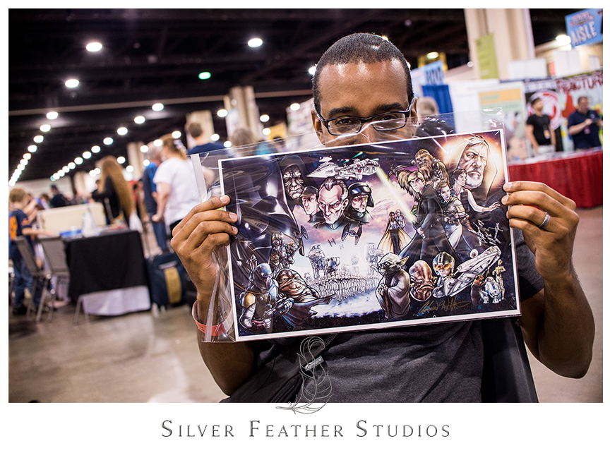 Brian shows off his new Star Wars print from Comfort and Adam he got at the Charlotte Convention Center during the Heroes Convention 2014, Charlotte Convention Center. © Silver Feather Studios