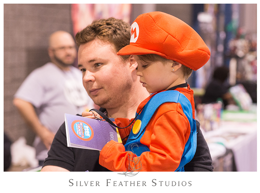 Cute kid dresses up as Mario from Mario Kart.© Silver Feather Studios, the nerdiest wedding photographers ever.