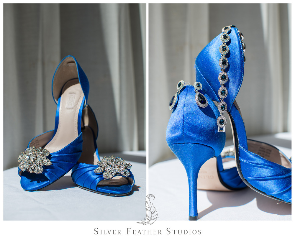 The bride wore beautiful rhinestone studded blue shoes at her wedding at the Empire Room. Photographed by Ariana Watts of Silver Feather Studios, a Burlington, NC wedding photography and videography company.