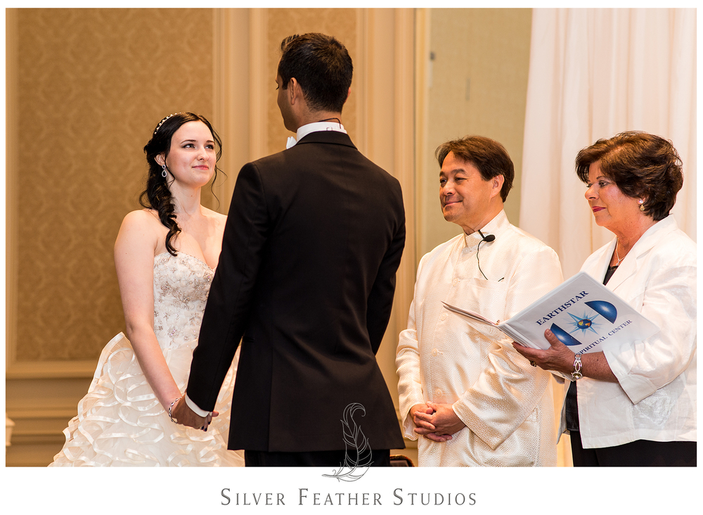 Madison looks adoringly at Harsh during their modern ceremony in Greensboro, NC. © Silver Feather Studios, Burlington, NC wedding photography and video.