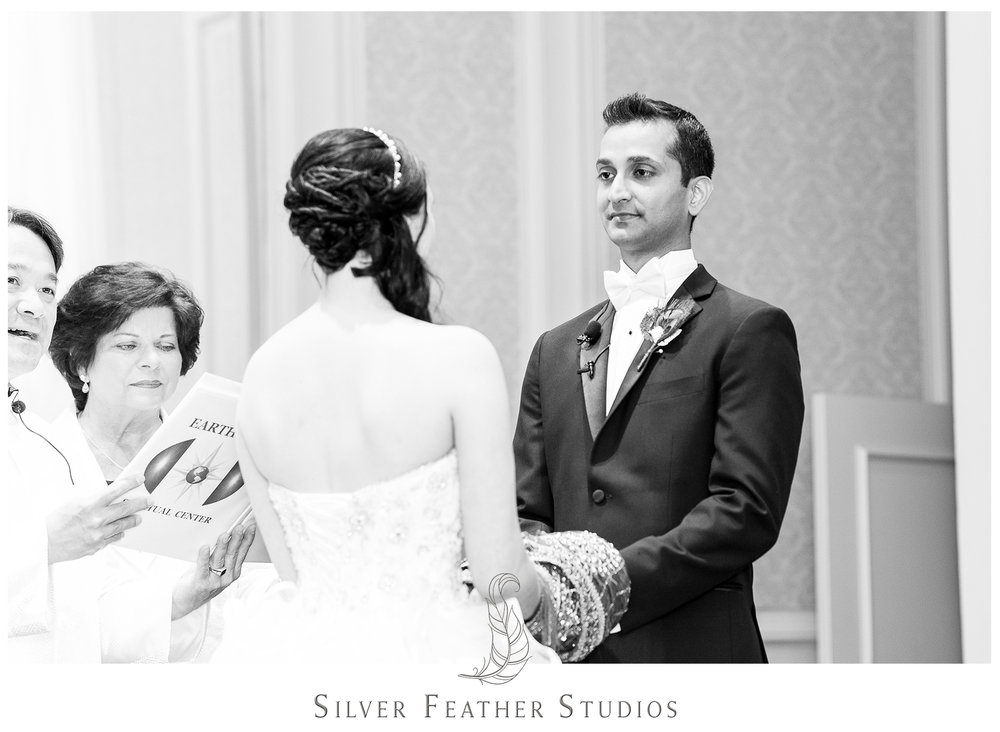 Harsh looks at his beautiful bride at their Empire Room wedding. Photographed by Ariana Watts of Silver Feather Studios, a Burlington, NC wedding photography and videography company.
