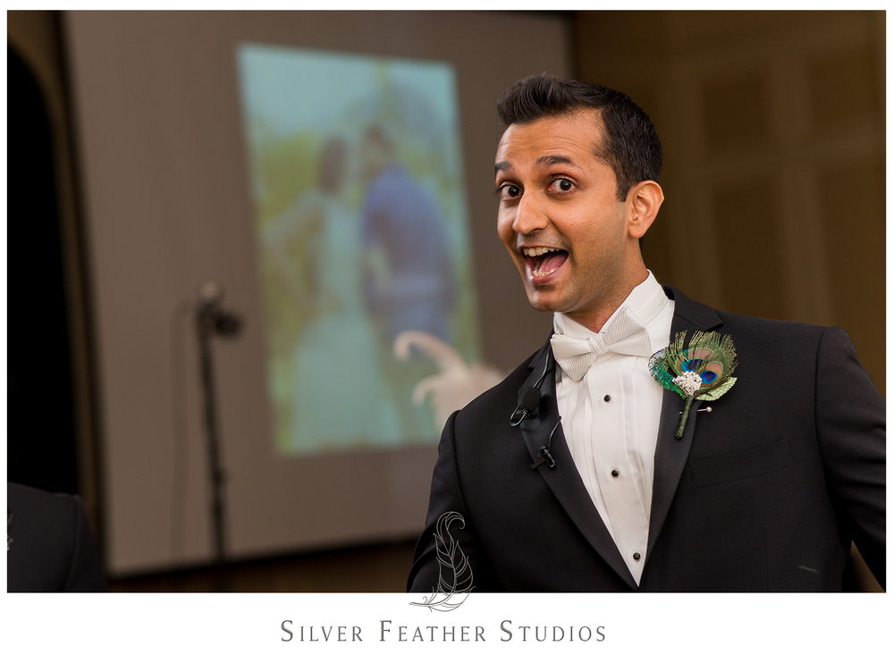 Harsh, showing off his peacock feather boutonniere, is excited now that he is a married man. © Silver Feather Studios, Greensboro wedding photography and videography.