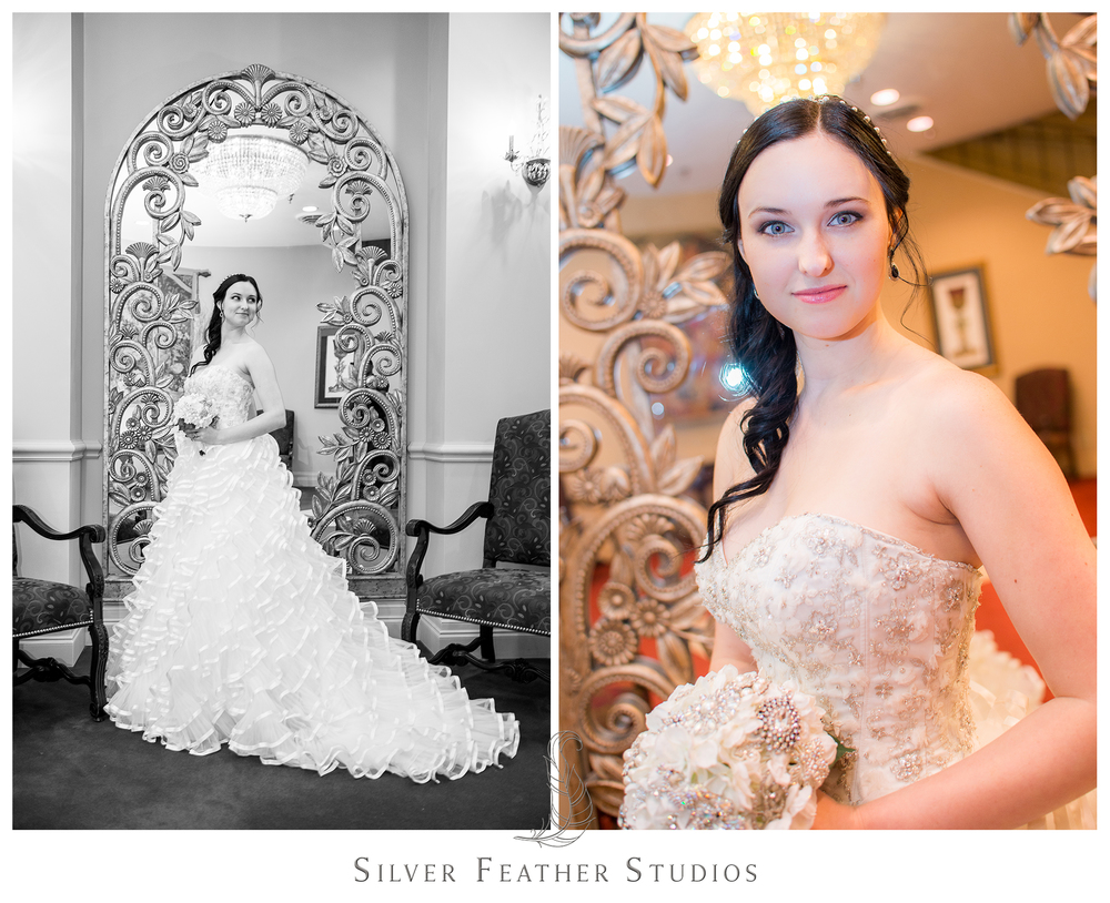 The bride Madison poses against the vintage mirror at The Empire Room in Greensboro. Photographed by Ariana Watts of Silver Feather Studios, a Burlington, NC wedding photography and videography company.