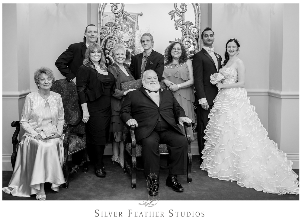 A new family portrait of Madison's family after their modern, nontraditional wedding ceremony at the Empire Room. © Silver Feather Studios, Greensboro wedding photography and videography.