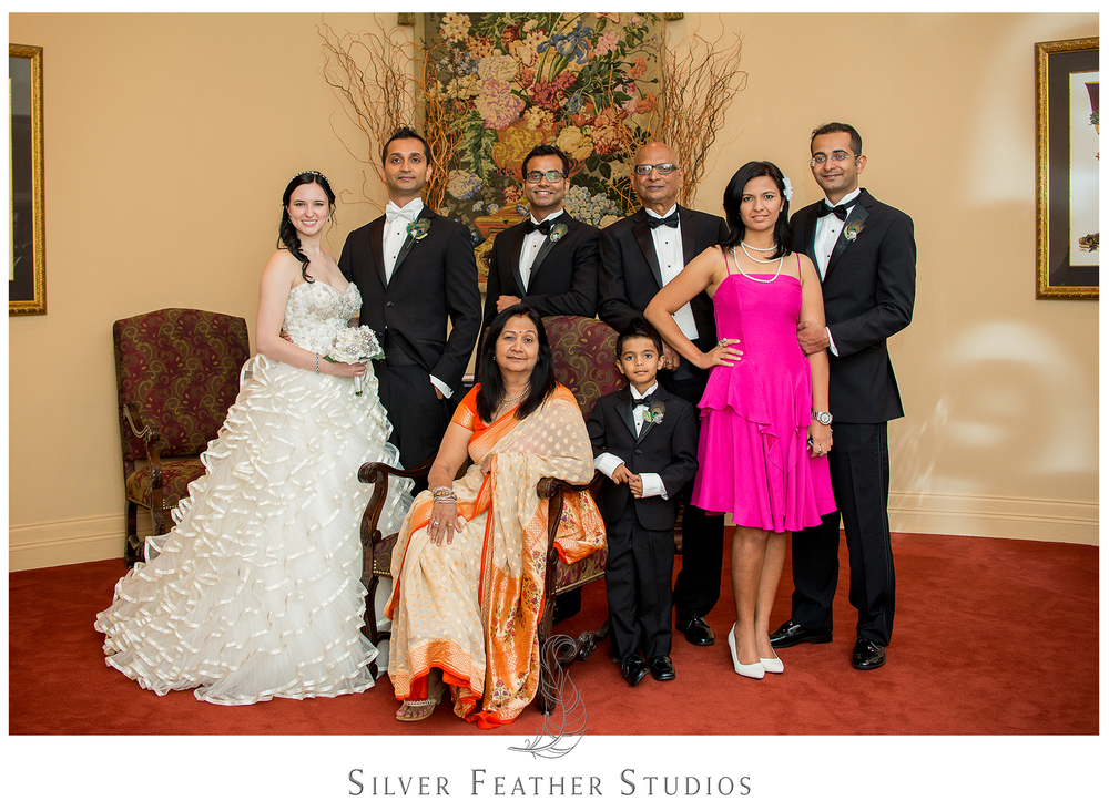 A new family portrait of Harsh's family after their modern, nontraditional wedding ceremony at the Empire Room. © Silver Feather Studios, Greensboro wedding photography and videography.