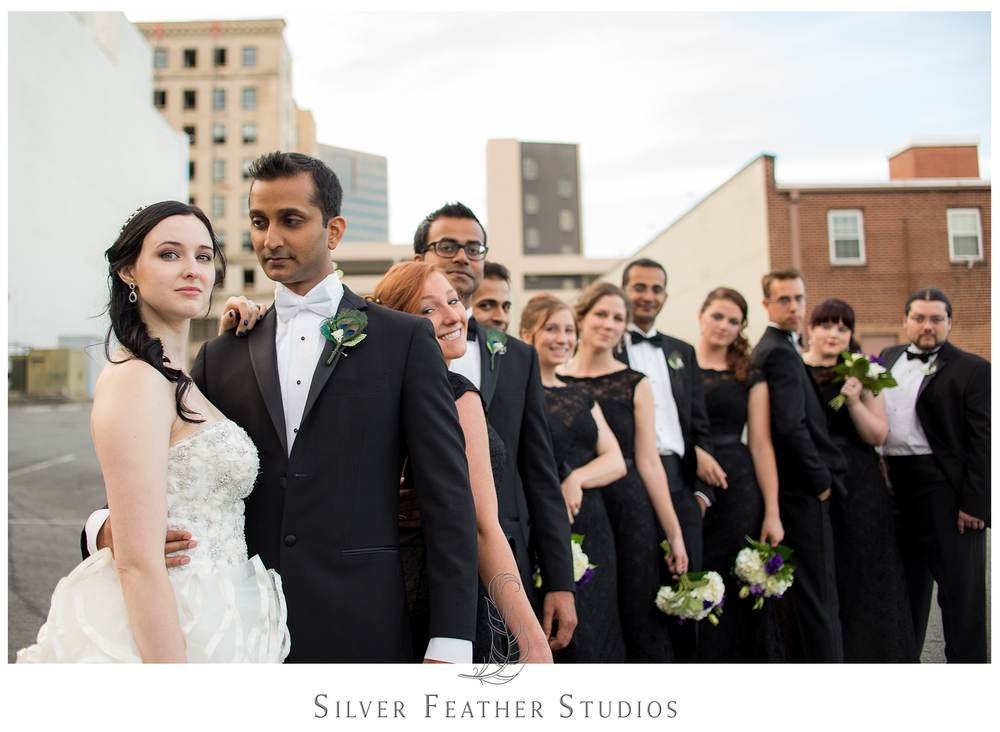 Madison and Harsh pose with their bridal party in downtown Greensboro, North Carolina. © Silver Feather Studios, Burlington, NC wedding photography and videography.