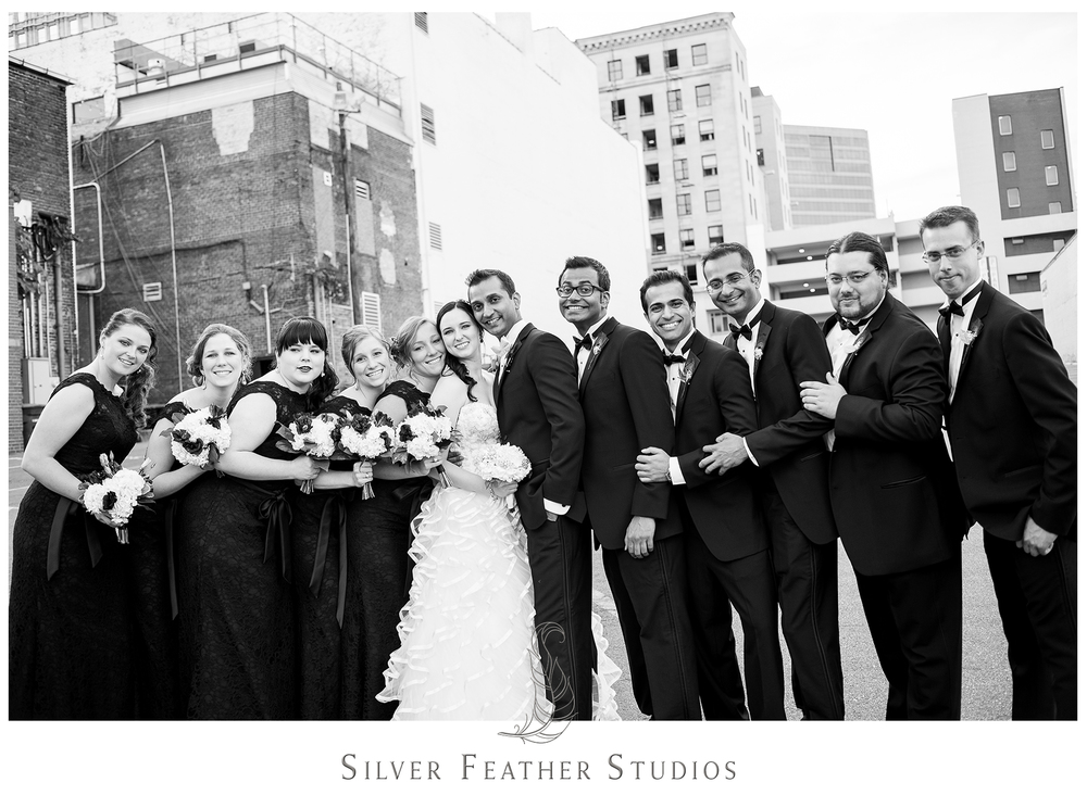 Black lace bridesmaid dresses and black tuxedoes adorn this Empire Room wedding bridal party. © Silver Feather Studios, Greensboro wedding photography and videography.