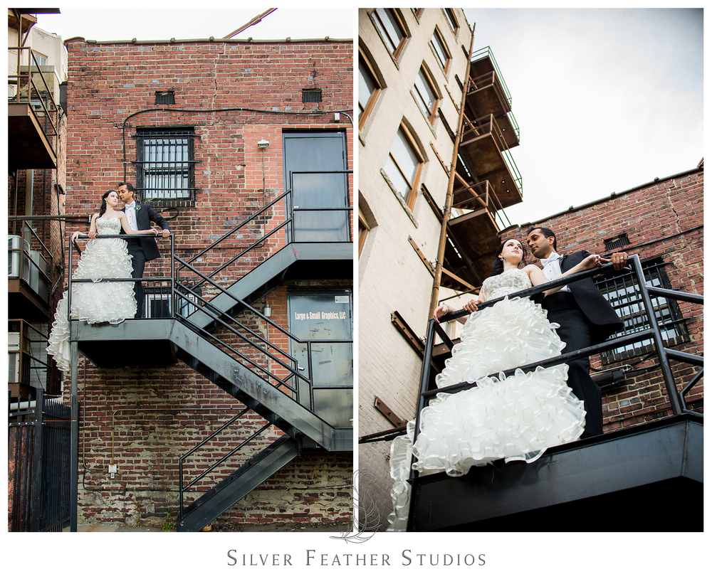 Madison and Harsh look breathtaking in the back alley staircases in downtown Greensboro, NC. © Silver Feather Studios, wedding photography in Burlington, North Carolina.