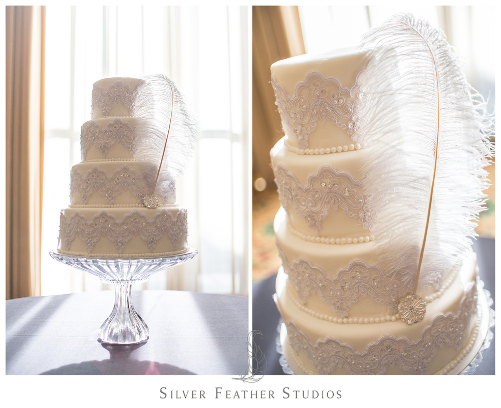 Stunning four tier ivory lace cake with feather adornment. Photographed by Ariana Watts of Silver Feather Studios, a Burlington, NC wedding photography and video.