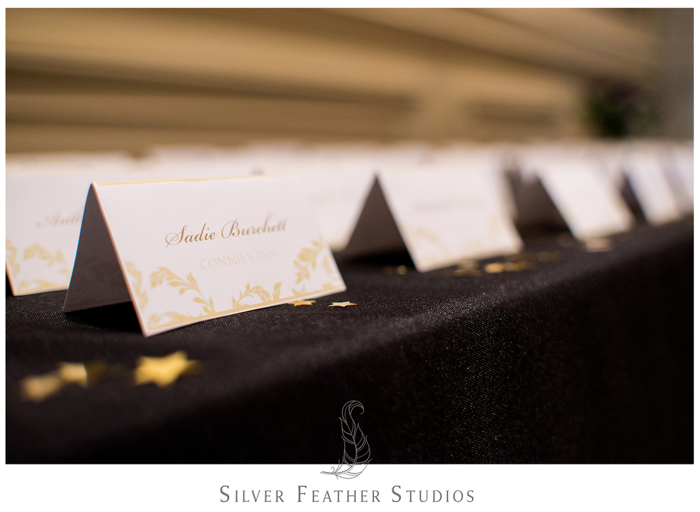 Gold foiled table cards at this Empire Room Wedding. © Silver Feather Studios, Greensboro wedding photography and videography.