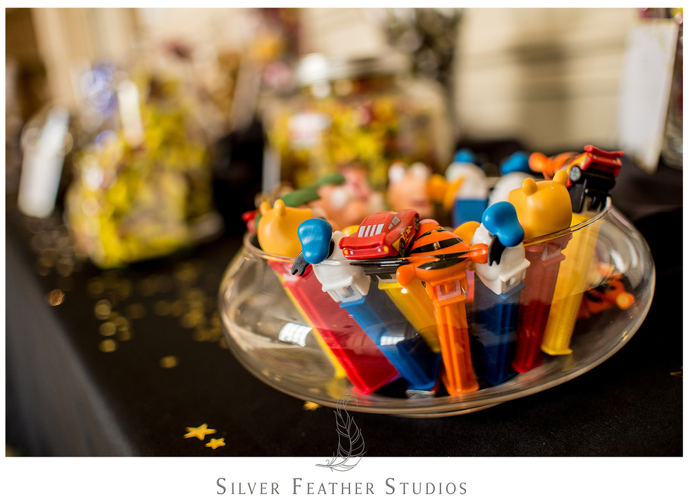 Pex dispensers at the gold decorated candy table. © Silver Feather Studios, Greensboro wedding photography and videography.