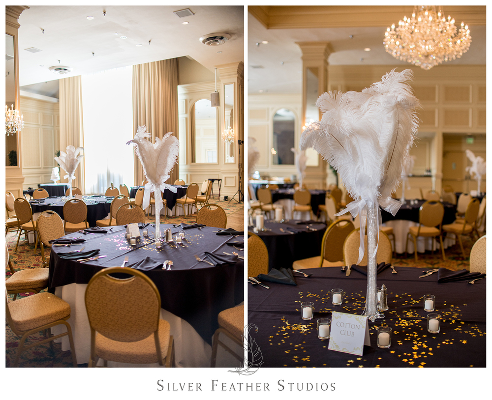 The Empire Room ballroom looks stunning with navy tablecloths and tall ostrich feather centerpieces. © Ariana Watts of Silver Feather Studios, Greensboro wedding photography and video.