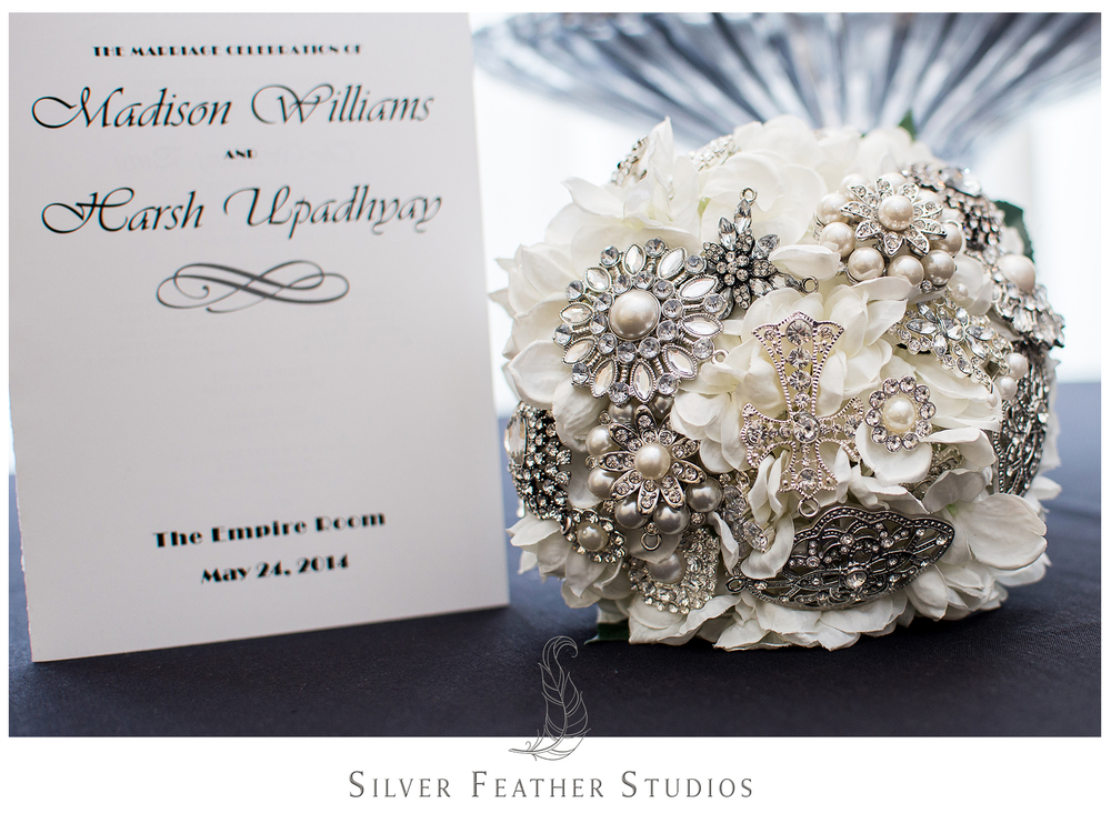 Bride's DIY silver brooch and faux floral bouquet for her feather inspired Empire Room wedding. Images by Silver Feather Studios, Greensboro wedding photography and cinematography.