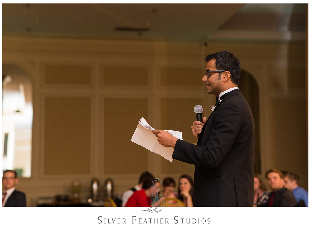 Heartfelt toasts given by the maid of honor and best man during this feather-inspired wedding in Greensboro. Photographed by Ariana Watts of Silver Feather Studios, a Burlington wedding photo and video company.