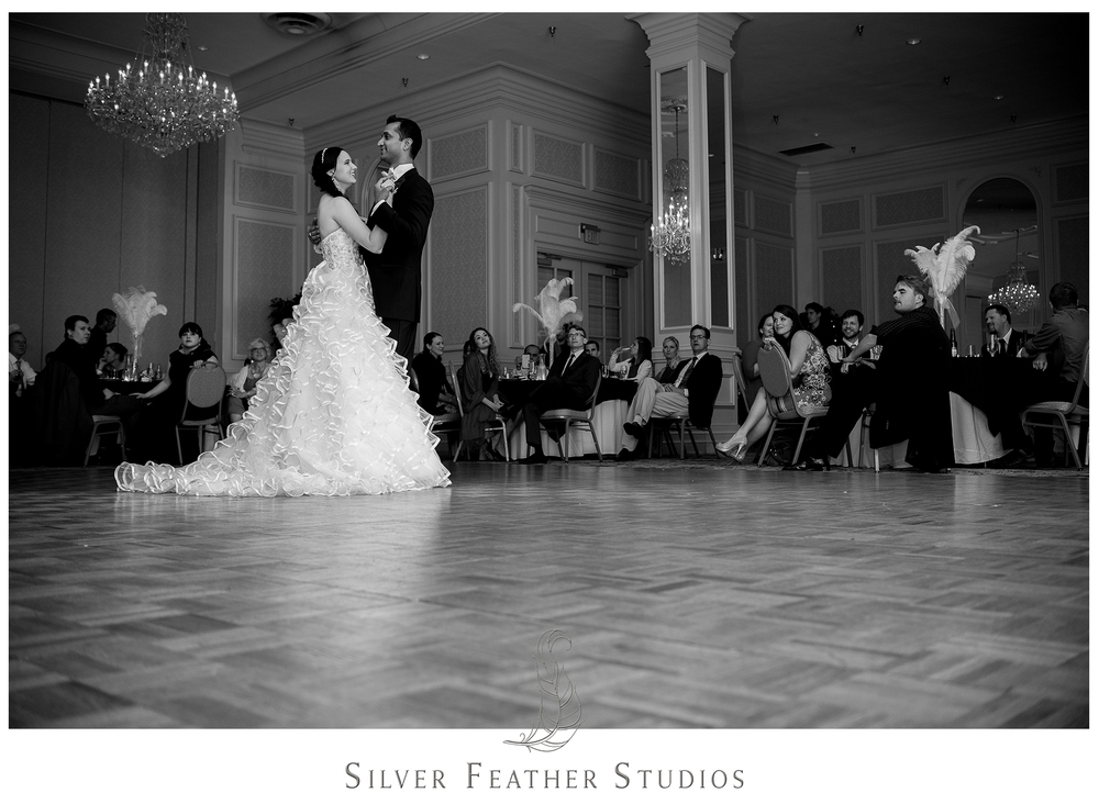 Madison and Harsh do their first dance at The Empire Room, which is stunning due to their ballroom training. © Silver Feather Studios, Greensboro wedding photography and videography.